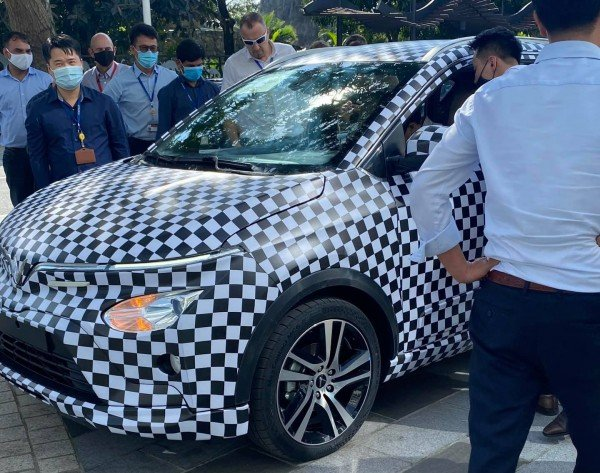 VinFast VF e34 electric car in tight camouflage for a test run in Hanoi